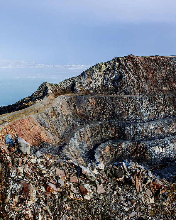 View from top of Panmaenmawr Quarry looking into the quarry and out to sea