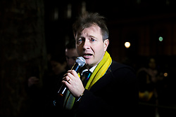 © Licensed to London News Pictures. 05/12/2017. London, UK. Richard Ratcliffe, husband of jailed British Iranian woman Naznin Zaghari Ratcliffe, speaks to carol singers outside Downing Street as they call on the government to secure her release before Christmas. Photo credit: Rob Pinney/LNP