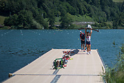 Lucerne, SWITZERLAND, 12th July 2018, Thursday, GBR LW4X Bow,  Madeleine ARLETT,  Elisha LEWIS, Gemma HALL, Francesca RAWLINS and coach, Darren WHITER,  The crew carry their boat from the pontoon after a training session, FISA World Cup III, Lake Rotsee, © Peter SPURRIER,