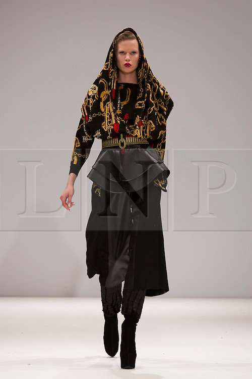 © Licensed to London News Pictures. 15 February 2014, London, England, UK. A model walks the runway at the Belle Sauvage show during London Fashion Week AW14 at Fashion Scout/Freemasons' Hall. Photo credit: Bettina Strenske/LNP