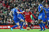 Harry Maguire of Leicester City (15) looks to tackle Mohamed Salah of Liverpool. Premier League match, Liverpool v Leicester City at the Anfield stadium in Liverpool, Merseyside on Saturday 30th December 2017.<br /> pic by Chris Stading, Andrew Orchard sports photography.