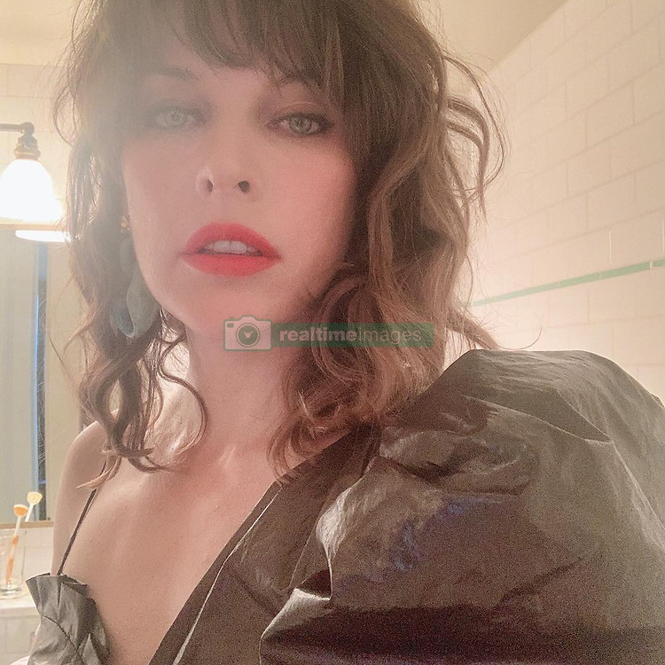 """Milla Jovovich releases a photo on Instagram with the following caption: """"Getting ready for the premiere of @hellboymovie!! So happy with my look! Sorry for all the shameless selfies, but...\ud83d\ude0e The dress by my girl @isabelmarant and my insanely rad coat by @claudemontanaofficiel designed by the super talented @byronesquevintage! Thanks @kryslelip for making this look a reality! Special thanks to my glam team: \nMake up: @therealistdotti \nHair: @luke_chamberlain"""". Photo Credit: Instagram *** No USA Distribution *** For Editorial Use Only *** Not to be Published in Books or Photo Books ***  Please note: Fees charged by the agency are for the agency's services only, and do not, nor are they intended to, convey to the user any ownership of Copyright or License in the material. The agency does not claim any ownership including but not limited to Copyright or License in the attached material. By publishing this material you expressly agree to indemnify and to hold the agency and its directors, shareholders and employees harmless from any loss, claims, damages, demands, expenses (including legal fees), or any causes of action or allegation against the agency arising out of or connected in any way with publication of the material."""