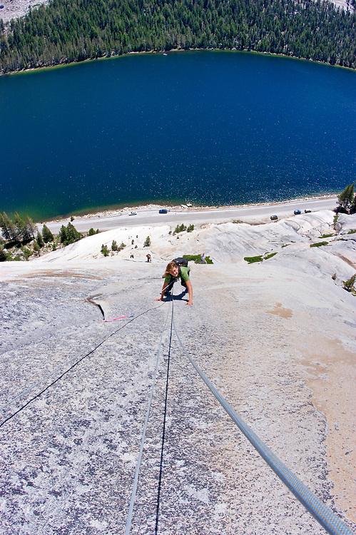 Climber on Stately Pleasure Dome above Tanaya Lake, Tuolumne Meadows area, Yosemite National Park, California