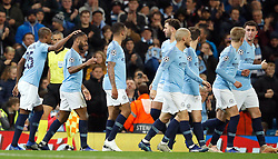Manchester City's Raheem Sterling (second left) celebrates scoring his side's third goal of the game with team-mates during the UEFA Champions League match at the Etihad Stadium, Manchester.