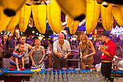 "01 SEPTEMBER 2011 - ST. PAUL, MN:  People play a ring toss game on the midway at the Minnesota State Fair. The Minnesota State Fair is one of the largest state fairs in the United States. It's called ""the Great Minnesota Get Together"" and includes numerous agricultural exhibits, a vast midway with rides and games, horse shows and rodeos. Nearly two million people a year visit the fair, which is located in St. Paul.   PHOTO BY JACK KURTZ"