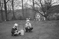 Forest and Lotus Hoben participate in a small Easter egg hunt outside their home during the coronavirus pandemic in the Hudson Valley, New York. Forest and Lotus Hoben, ages 10 and 6, were adopted from China and have albinism, a rare group of genetic disorders that cause the skin, hair, or eyes to have little or no color. Albinism is also associated with vision problems. According to the National Organization for Albinism and Hypopigmentation, about 1 in 18,000 to 20,000 people in the United States have a form of albinism.