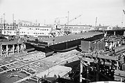 "ackroyd_10119-B02. ""Sause Bros. Barge 'Bandon of Portland' launching. December 28, 1960."" Albina Engine & Machine."