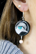 """Bird Eye Earrings by Star Nigro. <br /> Designed & handmade photo jewelry in the Hudson Valley, NY by Star Nigro. <br /> <br /> Materials: This set is made up of one of  my photos,freshwater pearls,sterling silver wire and sterling silver earring hooks.<br /> <br /> size: 1""""x1/8""""x 2""""<br /> <br /> price: $42.00<br /> <br /> photo by Star Nigro<br /> <br /> StarNigro.com<br /> <br /> ©2021 All artwork is the property of STAR NIGRO.  Reproduction is strictly prohibited."""