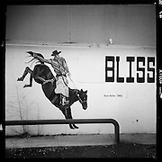 Cowboy on a bucking bronco painted on the side of a restaurant, Bliss, Idaho