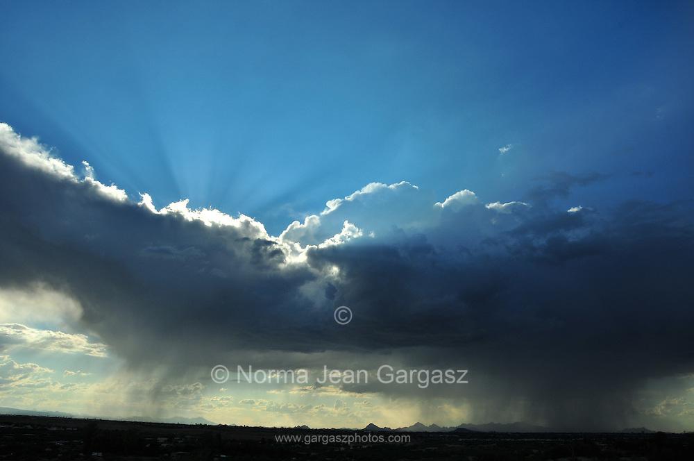 Clouds drop rain over the Sonoran Desert, Tucson, Arizona, USA.