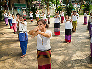 03 APRIL 2018 - CHIANG MAI, THAILAND: Women rehearse a traditional dance before Songkran in Chiang Mai, Thailand.  Songkran is the traditional Thai New Year festival and is celebrated April 13-15. The holiday is best known for raucous water fights but it is an important cultural and religious holiday.       PHOTO BY JACK KURTZ