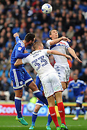 Wigan's Dan Burn (33) and Stephen Warnock (r) beat Cardiff city's Sean Morrison to a header. EFL Skybet championship match, Cardiff city v Wigan Athletic at the Cardiff city stadium in Cardiff, South Wales on Saturday 29th October 2016.<br /> pic by Carl Robertson, Andrew Orchard sports photography.