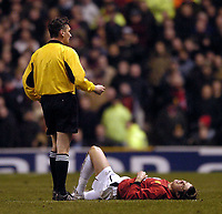 Photo. Jed Wee.<br /> Manchester United v FC Porto, UEFA Champions League, Old Trafford, Manchester. 09/03/2004.<br /> Manchester United's Christiano Ronaldo lies in agony only minutes after coming onto the pitch against his countrymen.
