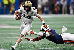 UCF Knights quarterback McKenzie Milton (10) runs fro a first down past an Auburn Tigers defender during the Chick-fil-A Peach Bowl NCAA college football game January 1, 2018, in Atlanta. (David Tulis via Abell Images for Chick-fil-A Peach Bowl)