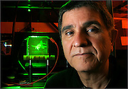 Dr. Nasser Peyghambarian with a refractable holographic image of an F-4 Phantom Jet created on a photorefractive polymer at the College of Optics, University of Arizona, Tucson, Arizona, USA.