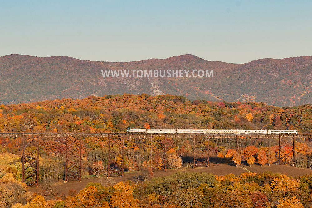 Cornwall, New York - A commuter train crosses the Moodna Viaduct railroad trestle on Oct.26, 2015. The mountains of the Hudson Highands on the east side of the Hudson River are in the background.