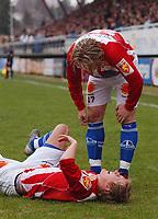 Morten Gamst Pedersen, Tromsø, nede for telling i første omgang. Skade. Tippeligaen 2004: Hamkam - Tromsø 1-1. 18. april 2004. (Foto: Peter Tubaas/Digitalsport).