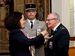 Veteran Harry Read, 92, from Bournemouth, receives the Legion d'honneur, France's highest distinction, from the French Ambassador Sylvie Bermann for his role in liberating France during the Second World War, during a ceremony at the Ambassador's residence in Kensington, London.