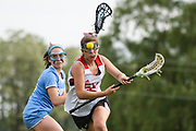 CVU's Becca Provost (15) and South Burlington's Ainsley Hultgren (10) chase down the ball during the girls lacrosse game between the South Burlington Wolves and the Champlain Valley Union Redhawks at CVU High School on Wednesday afternoon June 6, 2018 in Hinesburg. (BRIAN JENKINS/for the FREE PRESS)
