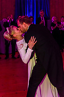 Norwegian bride and groom dance the first dance at their wedding reception, Trysil, Norway.