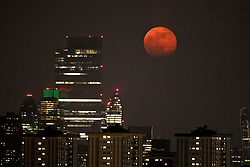 © Licensed to London News Pictures. 27/04/2021. London, UK. A full moon rises above the London Skyline, seen from Primrose Hill in North London. April's full moon, known as the Pink Moon, is the first of 2021. A supermoon occurs as the moon moves nearest to Earth during its elliptic orbit. Photo credit: Ben Cawthra/LNP