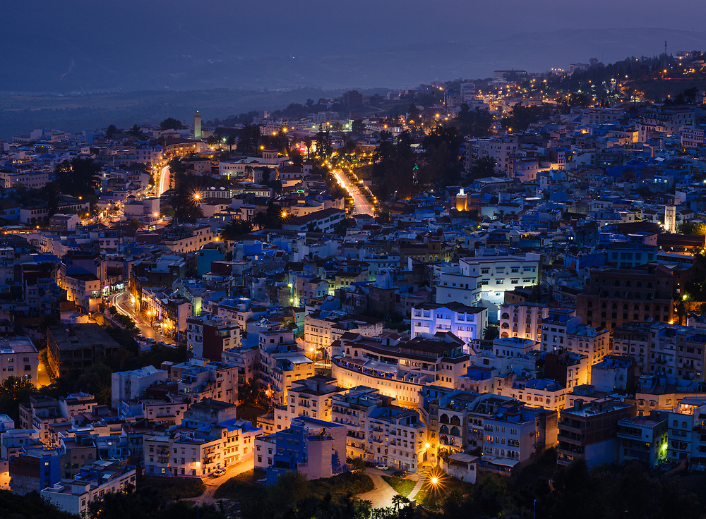 CHEFCHAOUEN, MOROCCO - CIRCA MAY 2018: Panoramic view of Chefchaouen and the Rif mountains at night.