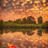 Mammatus at sunset over a lake in rural Missouri.