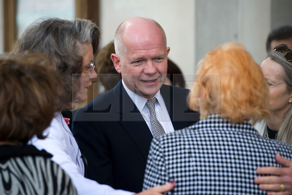 © Licensed to London News Pictures. 16/05/2012. London, UK. Foreign Secretary William Hague speaking to Rosemarie Colvin, mother of Marie Colvin as he arrives at St Martin in the Fields church, London for a memorial service held for American Sunday Times journalist Marie Colvin, who died covering the siege of Homs in Syria.  Photo credit : Ben Cawthra/LNP