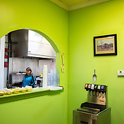 Owner of Thelma's On Main, Dawn Armstrong, walks through the kitchen as she helps prepare for the lunch rush on Monday, Feb. 8, 2016. Dawn opened Thelma's in late Dec. 2015 in downtown Orangeburg, SC.