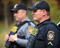 State Police secure the perimeter of a search area. Police continue to search for fugitive Eric Matthew Frein on Oct. 10, 2014, near Canadensis, PA. Frein is accused of shooting two Pennsylvania State Troopers fatally wounding one 28 days ago. (Chris Post | lehighvalleylive.com)