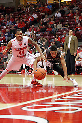 27 November 2015: DeVaughn Akoon-Purcell(44) and .q2 dive for a loose ball. Illinois State Redbirds host the Quincy Hawks at Redbird Arena in Normal Illinois (Photo by Alan Look)