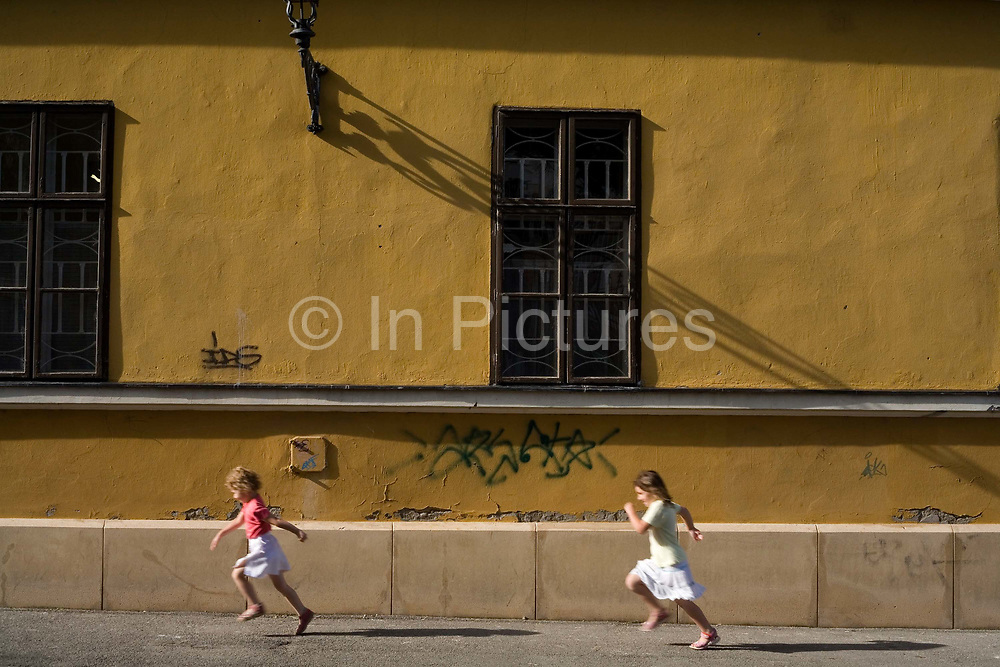Children running to school in Pecs.Pecs has been chosen as the 2010 European City of Culture. The city is on the southern slopes of the Mecsek Hills and has a sub-Mediterranean climate. Settled by Romans as Sopianae, it was a significant Christian settlement. Later conquered by the Ottomans, it has important Turkish architecture.