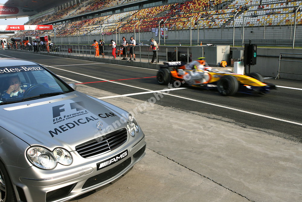 A Renault passes the medical car in the pits during practice for the 2007 Chinese Grand Prix in Shanghai. Photo: Grand Prix Photo