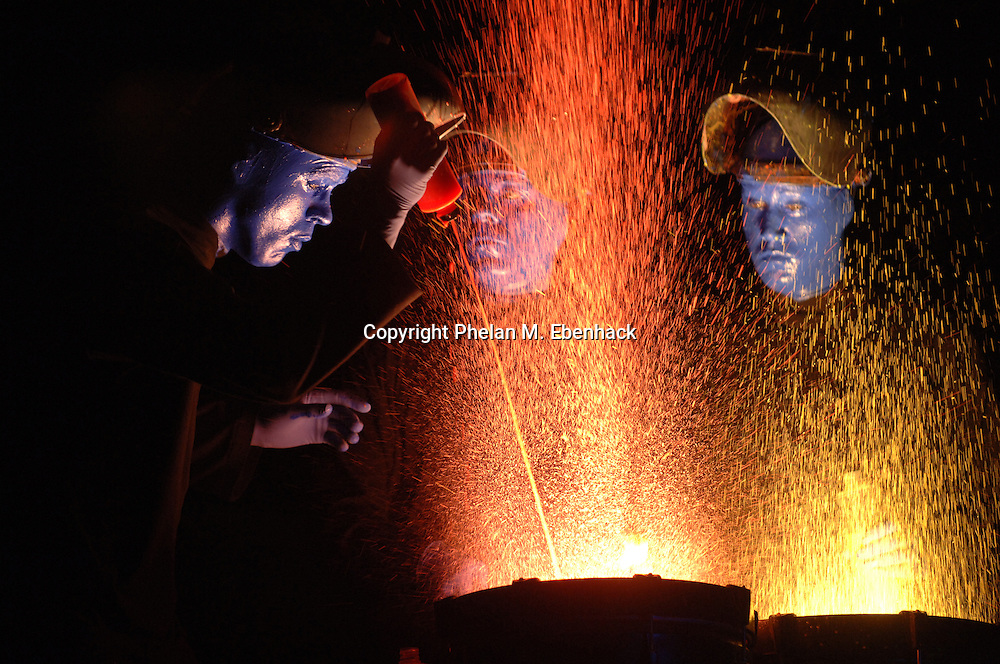 Members of the Blue Man Group perform at the Universal Studios Florida in Orlando, Florida.