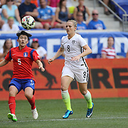Soo-yun Kim, (left), Korean Rebublic, clears from Amy Rodriguez, U.S. Women's National Team, during the U.S. Women's National Team Vs Korean Republic, International Soccer Friendly in preparation for the FIFA Women's World Cup Canada 2015. Red Bull Arena, Harrison, New Jersey. USA. 30th May 2015. Photo Tim Clayton