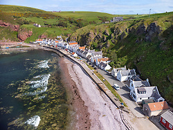 Aerial view from drone of village of Pennan on Moray Firth coast in Aberdeenshire, Scotland, UK