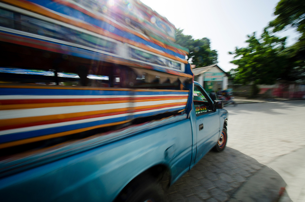 A tap-tap negotiates a corner in Archaie, Haiti
