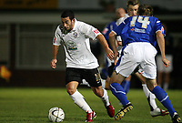 Photo: Rich Eaton.<br /> <br /> Hereford United v Leicester City. Carling Cup. 19/09/2006. Stuart Fleetwood of Hereford takes on Gareth McAuley of Leicester