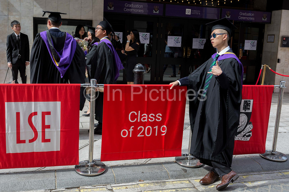 Immediately after their graduation ceremonies, new graduates meet relatives and family outside the London School of Economics LSE, on 22nd July 2019, in London, England.