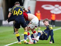 Middlesbrough's Paddy McNair is tackled by Stoke City's Rhys Norrington-Davies and Jack Clarke<br /> <br /> Photographer Alex Dodd/CameraSport<br /> <br /> The EFL Sky Bet Championship - Middlesbrough v Stoke City - Saturday 13th March 2021 - Riverside Stadium - Middlesbrough<br /> <br /> World Copyright © 2021 CameraSport. All rights reserved. 43 Linden Ave. Countesthorpe. Leicester. England. LE8 5PG - Tel: +44 (0) 116 277 4147 - admin@camerasport.com - www.camerasport.com