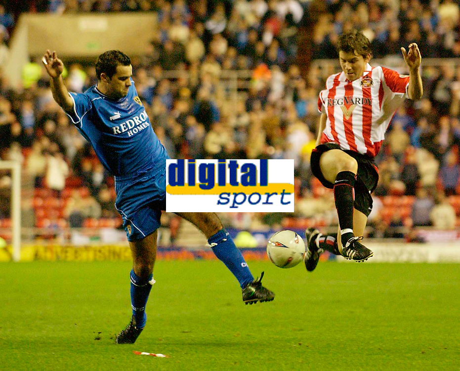 Photo. Jed Wee.<br /> Sunderland v Cardiff City, Nationwide League Division One, Stadium of Light, Sunderland. 14/10/03.<br /> Sunderland's John Oster (R) and Cardiff's Chris Barker scramble for the ball.
