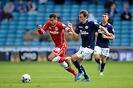 Ravel Morrison of Cardiff City breaks away from Edward Upson of Millwall. Skybet football league championship match , Millwall v Cardiff city at the Den in Millwall, London on Saturday 25th October 2014.<br /> pic by John Patrick Fletcher, Andrew Orchard sports photography.