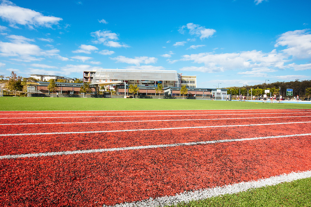 Exterior view across the sports field of St Peters Lutheran College at Springfield.