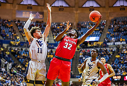 Dec 1, 2018; Morgantown, WV, USA; Youngstown State Penguins guard Garrett Covington (32) shoots while defended by West Virginia Mountaineers forward Emmitt Matthews Jr. (11) during the first half at WVU Coliseum. Mandatory Credit: Ben Queen-USA TODAY Sports