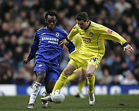 Photo: Lee Earle.<br /> Chelsea v Colchester United. The FA Cup. 19/02/2006. Chelsea's Michael Essien (L) battles with Mark Yates.