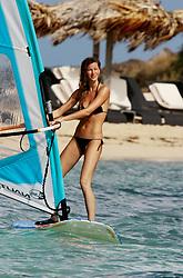 Brazilian top model Gisele Bundchen windsurfing in Saint Barthelemy, French West Indies on December 10, 2006. Photo by ABACAPRESS.COM  | 111691_13 Saint Barthelemy