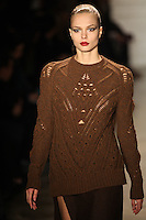 Katsia Zingarevich walks the runway wearing Altuzarra Fall 2011 Collection during Mercedes-Benz Fashion Week in New York on February 12, 2011