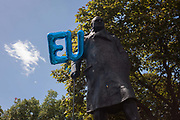 EU balloons float on the statue of Winston Churchill as thousands of British voters march through London to protest against the referendum decision to leave the EU Brexit on 2nd July 2016, in London UK. Demonstrators at the March for Europe rally, which was organised on social media walked from Park Lane into the heart of the UK government in Westminster to send a message of dissatisfaction in the referendum result. More than 46.5 million people voted in the referendum on 23 June, which resulted in the UK voting by 51.9% to 49.1% to withdraw from the EU.