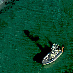 Aerial of lone Fisherman off the west coast of Florida fishing from boat