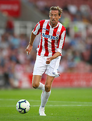 """Stoke City's Peter Crouch during a pre season friendly match at The Bet365 Stadium, Stoke. PRESS ASSOCIATION Photo. Picture date: Wednesday July 25, 2018. Photo credit should read: Nick Potts/PA Wire. EDITORIAL USE ONLY No use with unauthorised audio, video, data, fixture lists, club/league logos or """"live"""" services. Online in-match use limited to 75 images, no video emulation. No use in betting, games or single club/league/player publications."""
